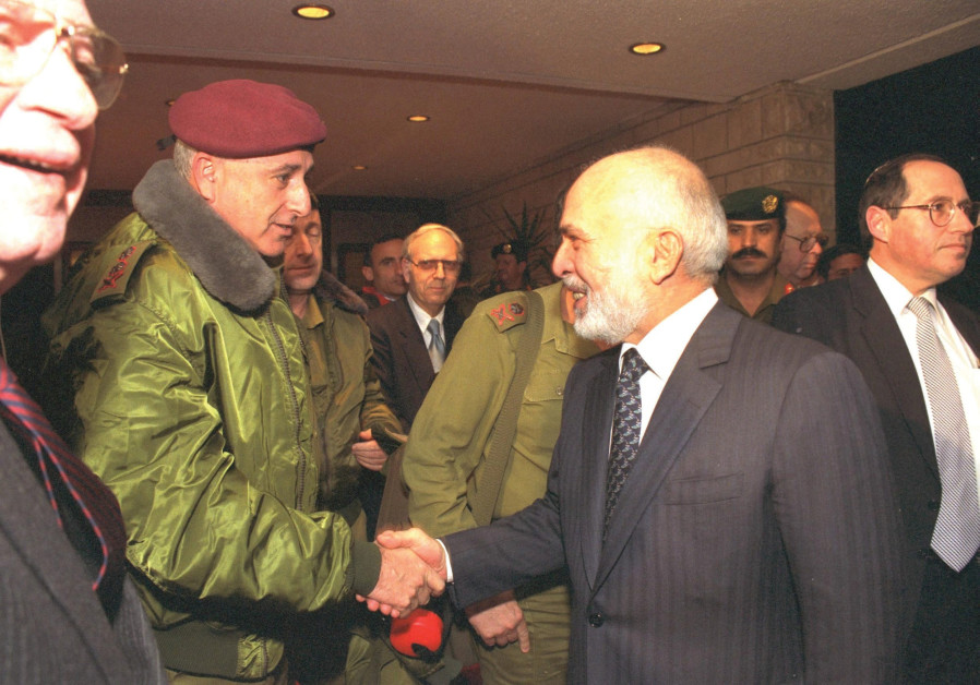 HALEVY (CENTER back) looks on as Jordan's King Hussein shakes hands with IDF chief of staff Amnon Lipkin Shahak at the royal palace in Amman on January 12, 1995. (Maariv)