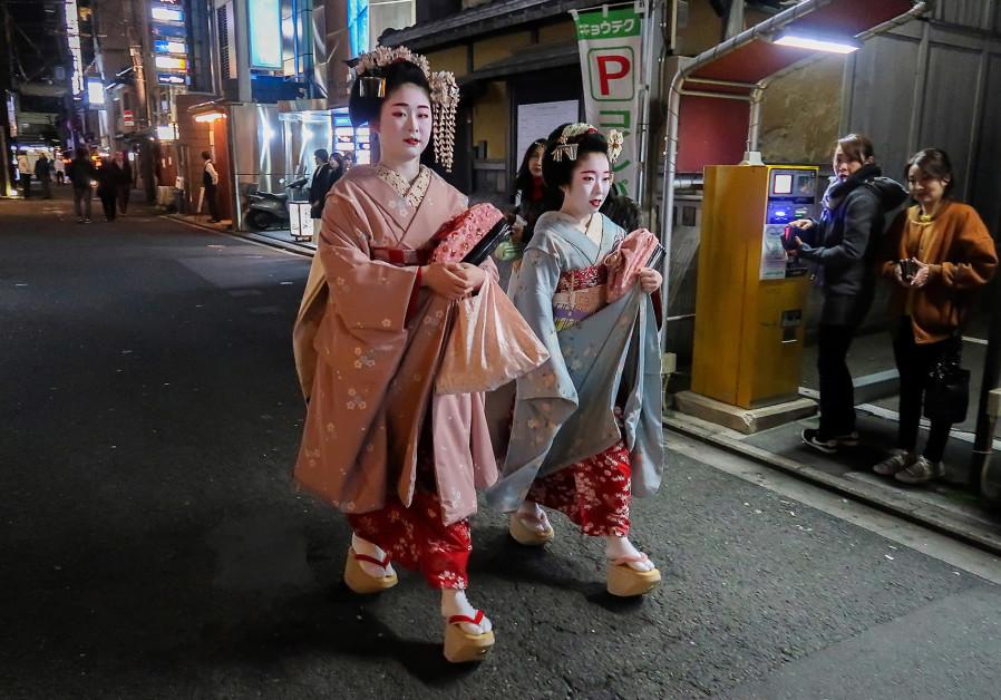 A PAIR of Geisha walk through the Gion neighborhood of Kyoto.