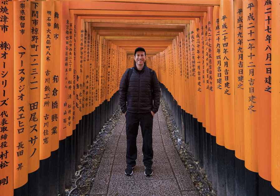 THE WRITER-PHOTOGRAPHER stands among some of the thousands of wooden gates that make up the Fushimi-Inari