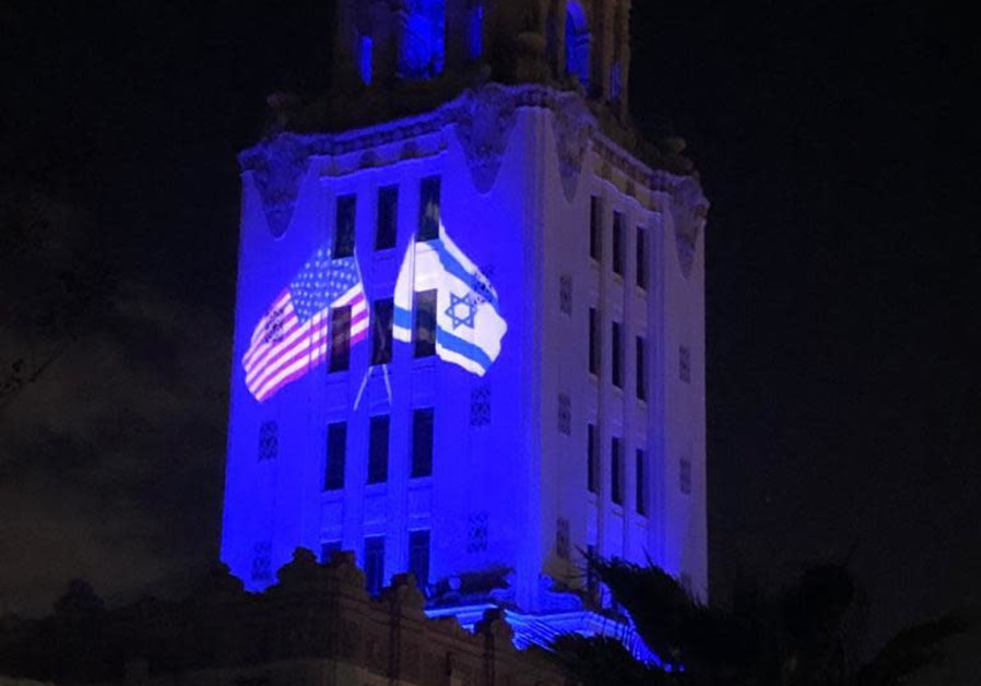 The Beverly Hills City Hall building lights up in blue, and shines an American and Israeli flag intertwined, in honor and celebration of Israel's 73rd Indepenedence Day, April 15, 2021. (Credit: FOREIGN MINISTRY)