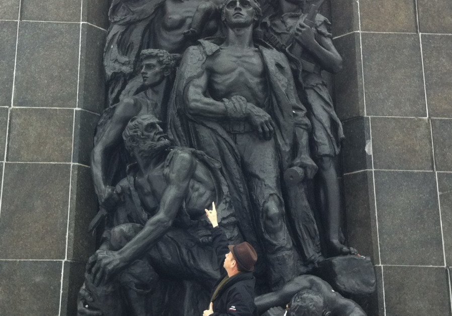 Ofer Aloni visiting Nathan Rappaport's Monument to the Ghetto Heroes in Warsaw, depicting a young woman believed to be Rachel Sarenka Zylberberg (Credit: Courtesy)