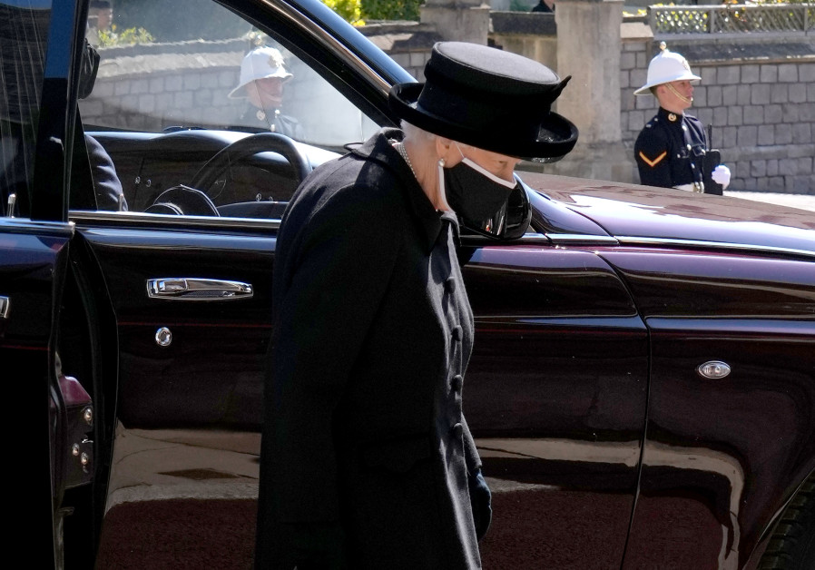 Britain's Queen Elizabeth II arrives for the funeral of Britain's Prince Philip, who died at the age of 99, at St George's Chapel, in Windsor, Britain, April 17, 2021. (JONATHAN BRADY/POOL VIA REUTERS)