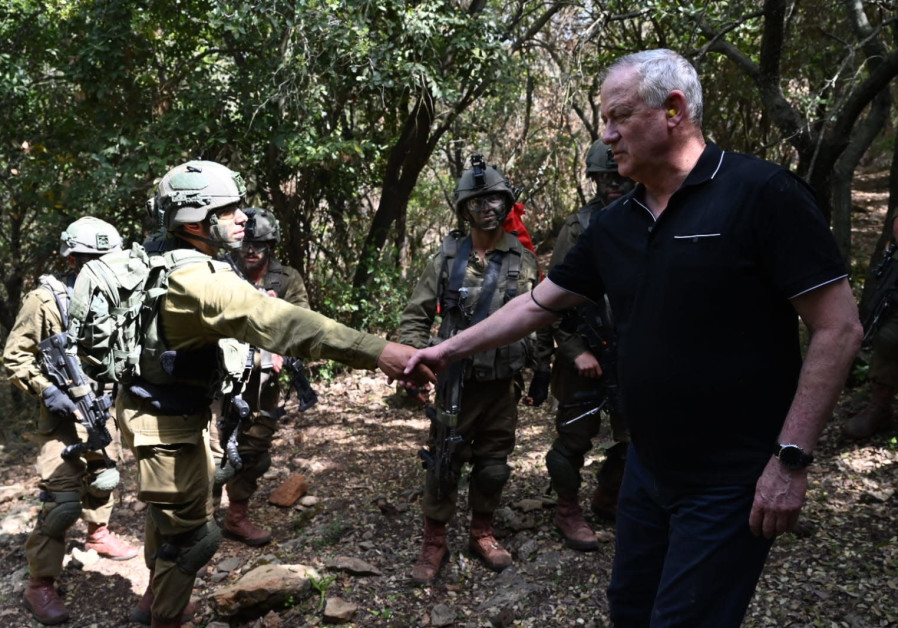 Defense Minister Benny Gantz shakes hands with IDF soldier on Northern Front (photo credit: Ariel Hermoni/ Defense Ministry).