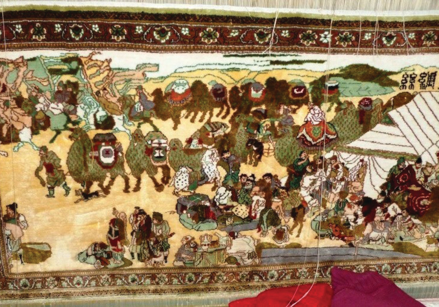 THE PRAYER book may have belonged to the Radhanites, medieval merchants who traded along the Silk Road. (Pictured: Moden carpet illustrating camel caravan on Silk Road; Wikimedia Commons)