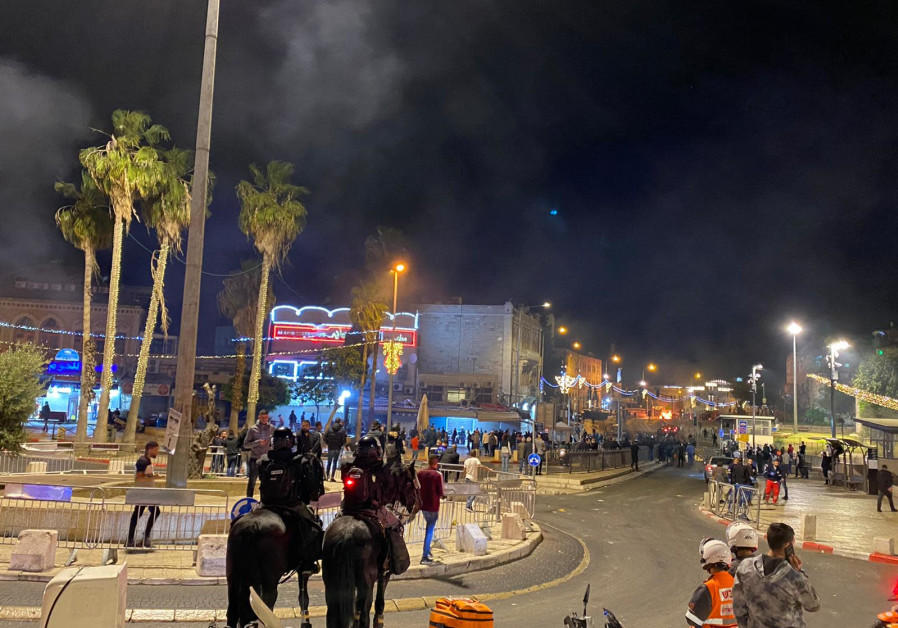 Fires burn through dumpsters as the protests at Damascus Gate in Jerusalem's Old City continue, April 22, 2021. (Credit: SETH J. FRANTZMAN)