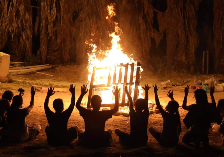 Children sit around a bonfire in Arnona, Jerusalem (Marc Israel Sellem)