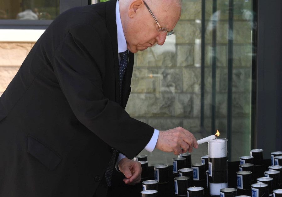 President Reuven Rivlin lighting 45 candles in honor of the victims from Mount Meron, April 30, 2021. (Credit: MARK NEYMAN/GPO)