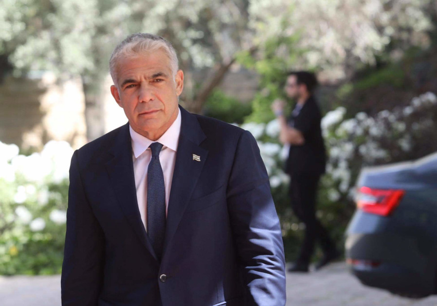 Opposition leader and Yesh Atid chairman Yair Lapid arrives at the President's Residence (Marc Israel Sellem/The Jerusalem Post)