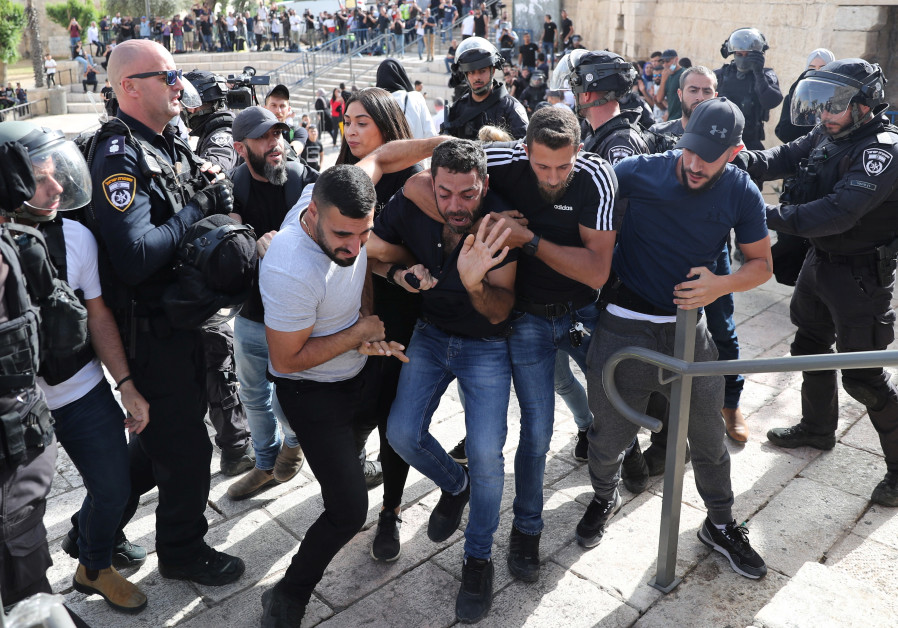 A Palestinian man reacts as he is detained by undercover Israeli security force members amid Israeli-Palestinian tension as Israel marks Jerusalem Day, near Damascus Gate just outside Jerusalem's Old City. (Photo credit: Ronen Zvulun/Reuters)