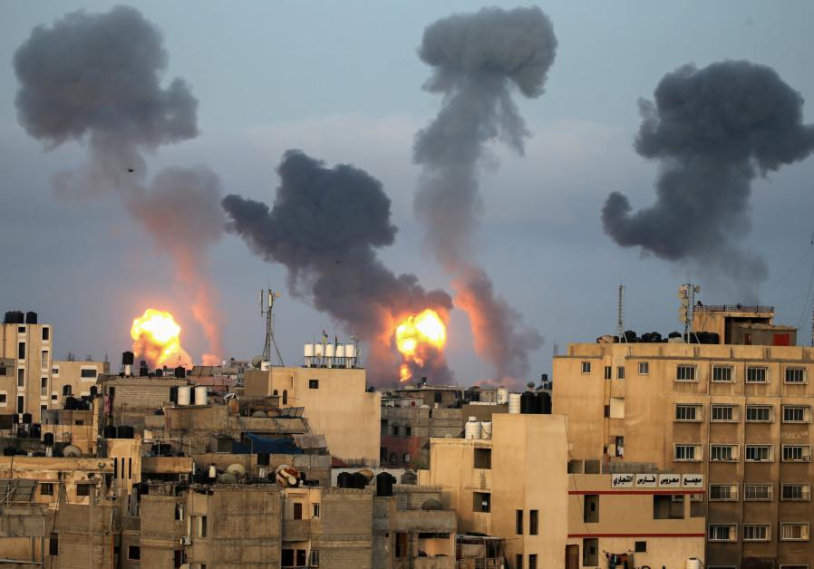 Flames and smoke rise during Israeli air strikes amid a flare-up of Israel-Palestinian violence, in the southern Gaza Strip May 11, 2021. (Credit: Reuters/Ibraheem Abu Mustafa)