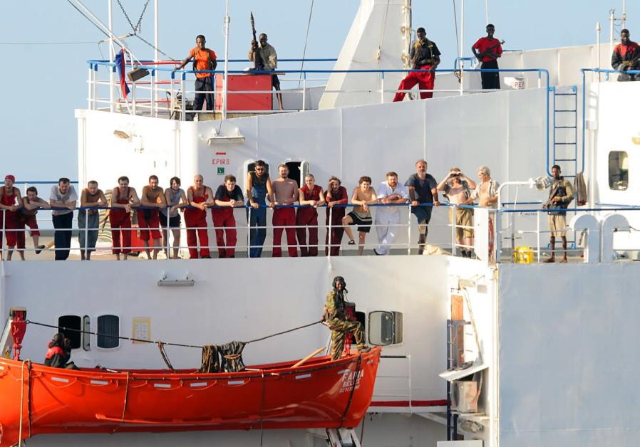 SOMALI PIRATES aboard the 'MV Faina.' (Photo credit: Wikimedia Commons)