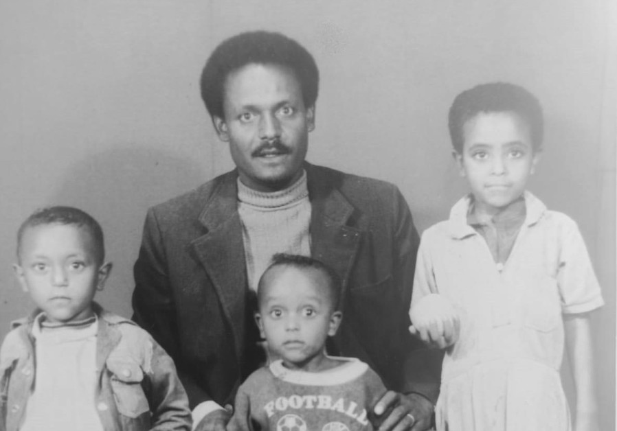 RACHELI TADESA MALKAI together with brothers Eli and Asher and their father after receiving documents. (Jewish Agency)