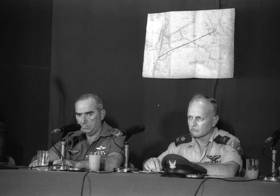 IDF CHIEF of staff Rafael 'Raful' Eitan and Air Force commander David Ivri inform journalists about the operation, June 9, 1981. (Credit: HERMAN CHANANIA/GPO)