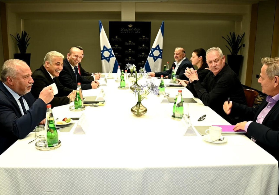 Naftali Bennett and Yair Lapid meet with the party leaders who make up their new coalition on June 6, 2021 (Photo credit: ELAD GUTTMAN)