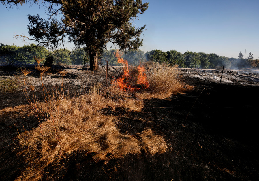 A field on fire is seen after Palestinians in Gaza sent incendiary balloons over the border between Gaza and Israel, Near Nir Am (Credit: Reuters)