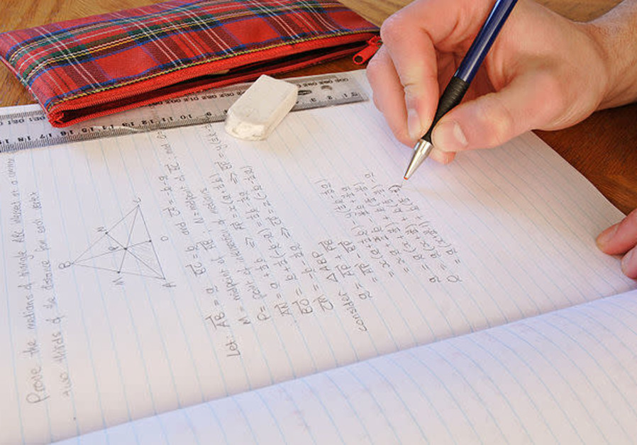 Child doing homework (Credit: Wikimedia Commons)