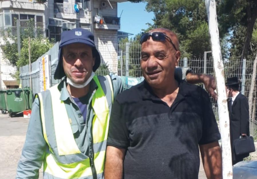 HISHAM AMIN (right) and Yaniv Yosef Mizrahi: 60 years of combined tree-planting skill. (Credit: NATAN ROTHSTEIN)