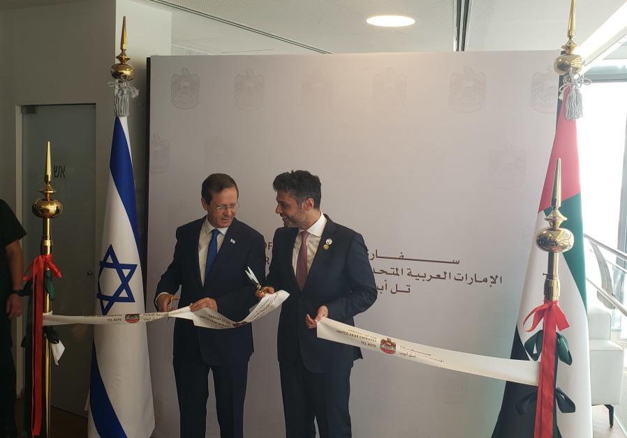 President Isaac Herzog and UAE Ambassador to Israel Mohamed Al Khaja cutting the ribbon at the new Emirati Embassy in Tel Aviv, July 14, 2021. (Credit: BEN BARUCH)
