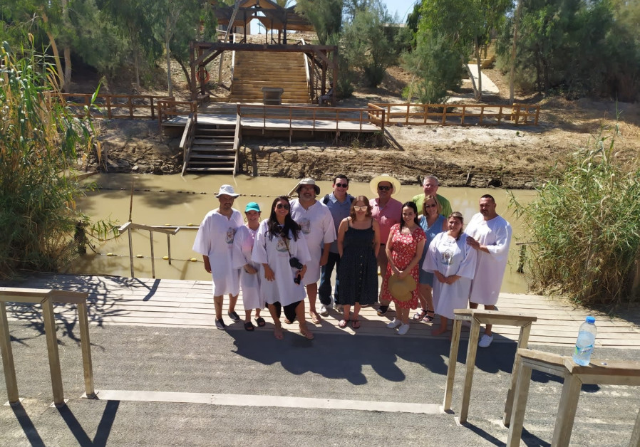 Participants in the Center for Latino-Jewish Relations trip at the site of Jesus' baptism, on the Jordan River.