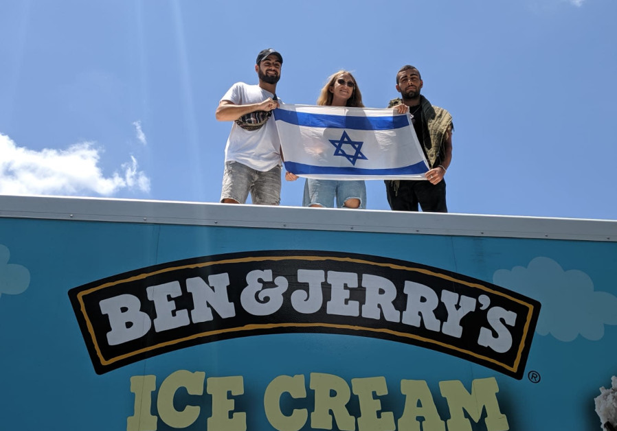 Hallel Silverman and two other members of the Digitell visiting group stand on a Ben & Jerry's Ice Cream truck.