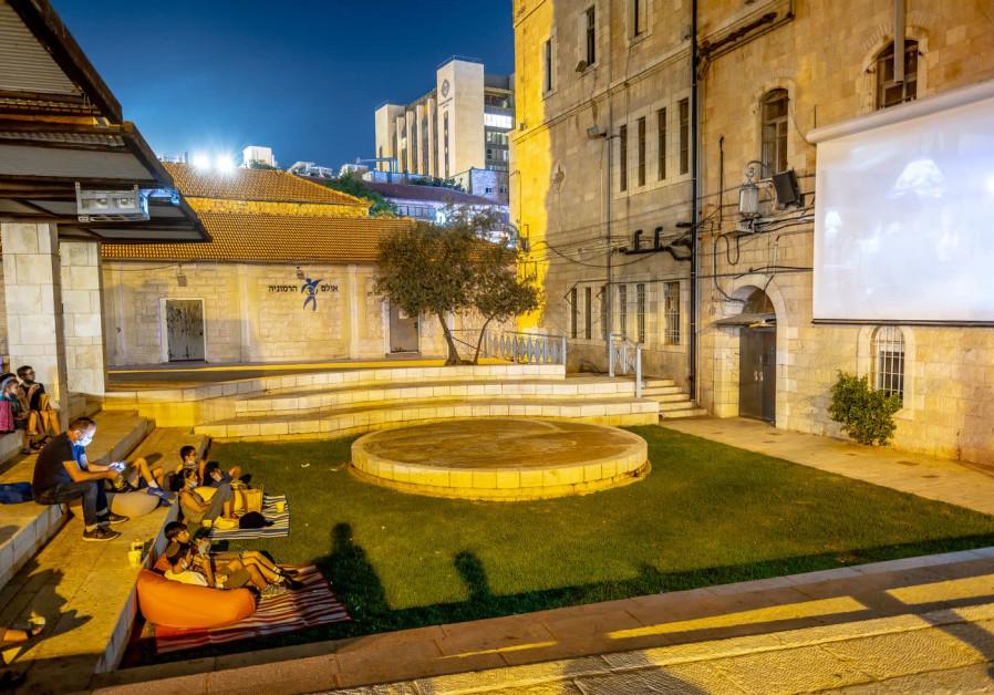 Jerusalem residents watch a film in Kikar HaYareach as part of the Moonlight Cinema project organised by the Jerusalem Municipality (Credit: HODAYA TOLEDANO)