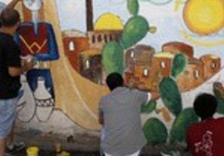 Palestinians paint a mural in al-Amari refugee camp in Ramallah ,May 13, 2013.