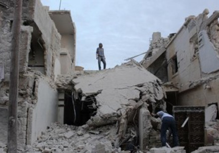 Residents inspect wreckage after Syrian army bombardment in Qatana, Aleppo.
