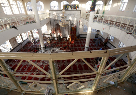 Afghan men inspect inside a Shi'ite Muslim mosque after an attack in Kabul, Afghanistan.