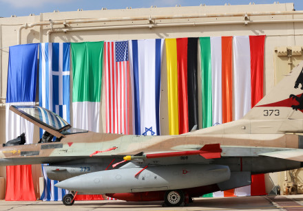 Israeli F16 stationed next to flags of participating nations
