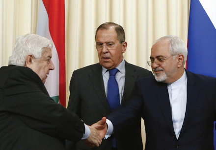 FOREIGN MINISTERS Sergei Lavrov (C) of Russia, Walid al-Muallem (L) of Syria and Mohammad Javad Zari