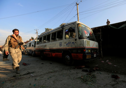 Afghan security forces inspects the site of a suicide attack in Jalalabad city, Afghanistan
