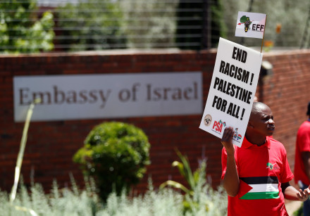 A protestor outside the Israeli embassy in Pretoria, South Africa
