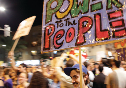 A MAN holds a sign during the 2011 'Summer of Discontent' protest when hundreds of thousands marched