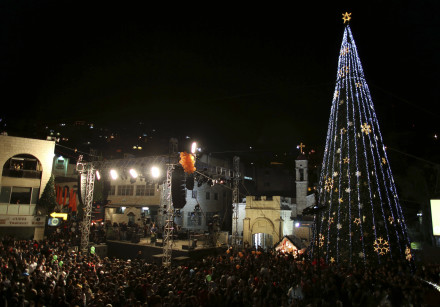 People attend a Christmas tree lighting ceremony in Nazareth