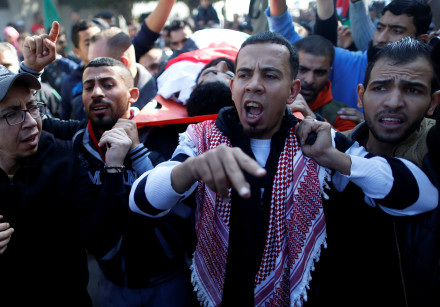 Mourners carry the body of Palestinian wheelchair-bound protestor, Ibrahim Abu Thuraya