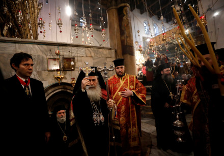 The Greek Orthodox Patriarch of Jerusalem Theophilos III attends a Christmas service according to th