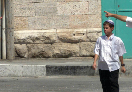 JEWISH SETTLERS argue with a Palestinian in Hebron in August 2001
