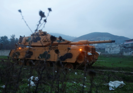 A Turkish military tank arrives at an army base in the border town of Reyhanli near the Turkish-Syri