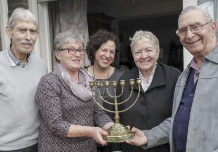 Menorah that belonged to Auschwitz victims returns to grandson