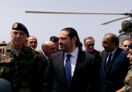 Lebanese Prime Minister Saad al-Hariri arrives with Army Commander General Joseph Aoun (L) at the Un