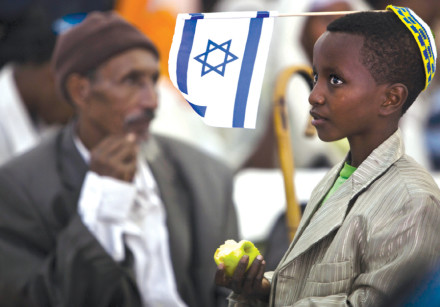 A YOUNG immigrant from Ethiopia waits upon his arrival at Ben-Gurion in 2012