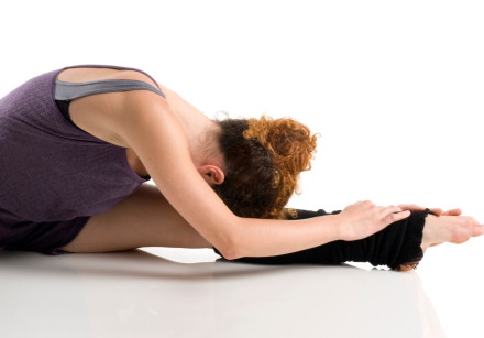 A dancer stretches