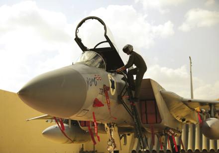 An Israeli pilot enters his aircraft.