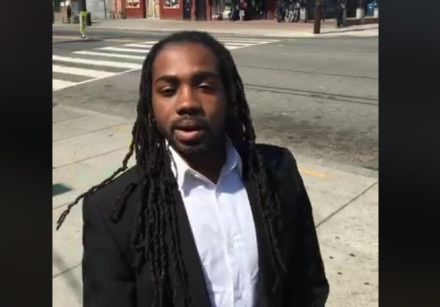 Councilman Trayon Shite Sr. records a video on a street corner in Washington, DC