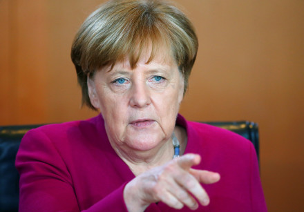 Angela Merkel gestures during a cabinet meeting in Berlin