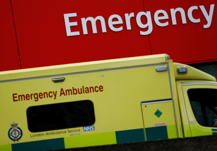 An ambulance waits outside the emergency department in London, Britain