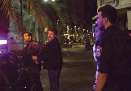 Police arrest Jafar Farah, director of the Mossawa Center, in Haifa on Friday night.