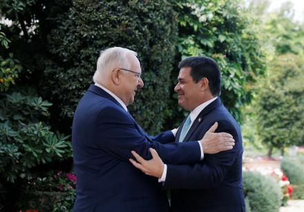 Israeli President Reuven Rivlin embraces Paraguayan President Horacio Cartes upon his arrival