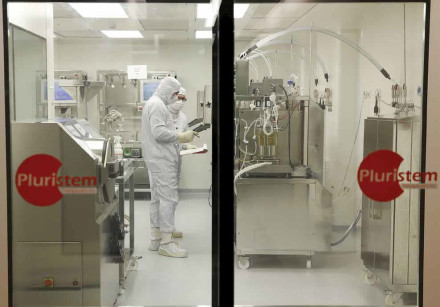 Biologists work in a laboratory at Pluristem Therapeutics Inc. in Haifa