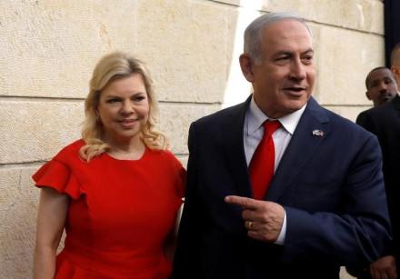 Israeli Prime Minister Benjamin Netanyahu and his wife Sara Netanyahu stand next to the dedication p